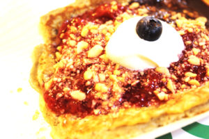Whole meal pancakes with berry coulis, fresh cream and nuts www.andthentherewasfood.co.za